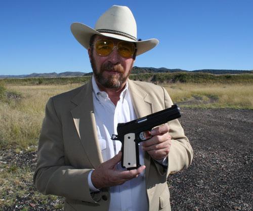 Sheriff Jim Wilson holding gun