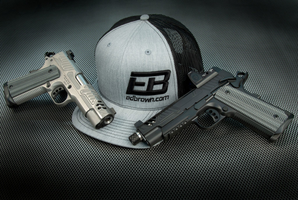 pair of Ed Brown ZEV pistols with hat